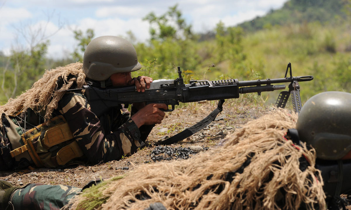 A Philippine soldier fires a machine gun during a live fire exercise at Fort Magsaysay, in Nueva Ecija province north of Manila on May 10, 2014. – Photo by AFP