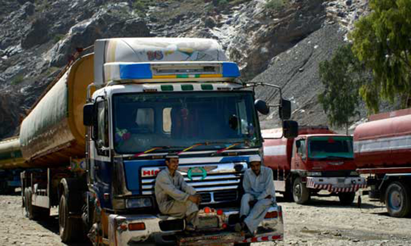 File photo shows Pakistani drivers sitting on a front bumper of a truck carrying supplies for Nato forces in Afghanistan. —AP/File photo
