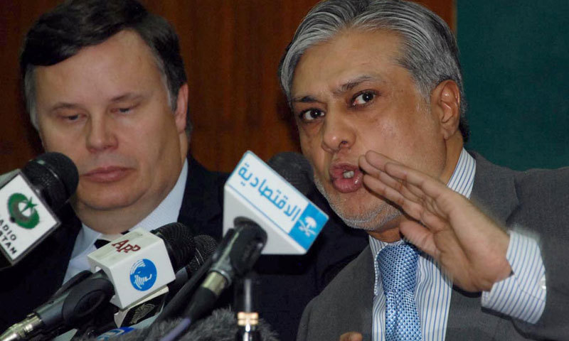 File photo shows Pakistan Finance Minister Ishaq Dar and Jeffrey Franks, the chief for the IMF Pakistan mission.— File Photo by INP