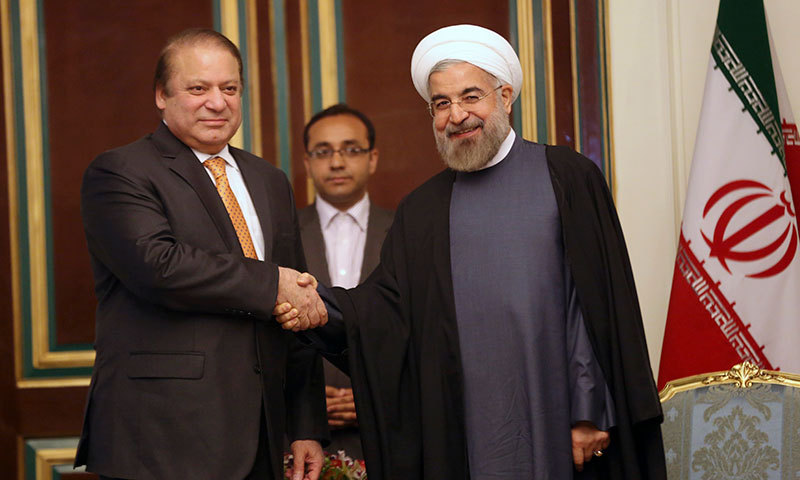 Iranian President Hassan Rouhani shakes hands with Pakistani Prime Minister Nawaz Sharif at the start of their meeting in Tehran on Sunday, May 11, 2014. – AP Photo