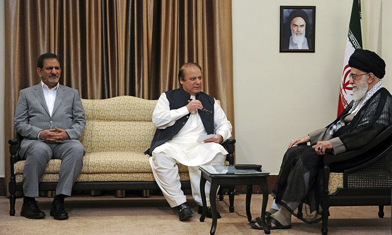 A handout picture released by the office of Iran's Supreme Leader Ayatollah Ali Khamenei on May 12, 2014 shows him (R) meeting with Pakistan's Prime Minister Nawaz Sharif (C) in the presence of Iran's First Vice President Eshaq Jahangiri (L) in Tehran. — Photo by AFP