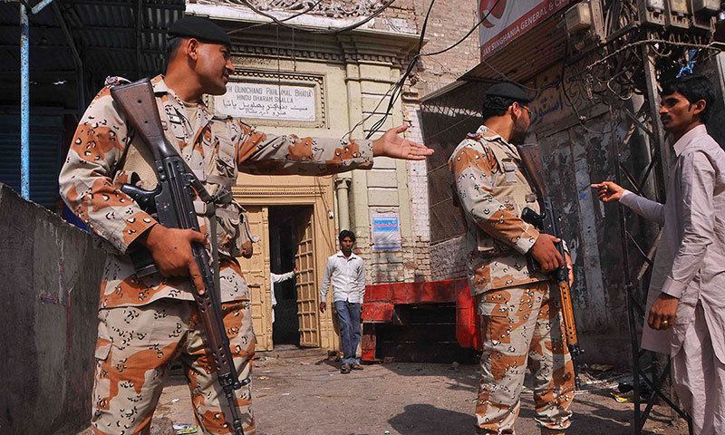 Paramilitary soldiers stand guard outside a temple that was attacked in Larkana, Sindh. — Photo by Reuters/File
