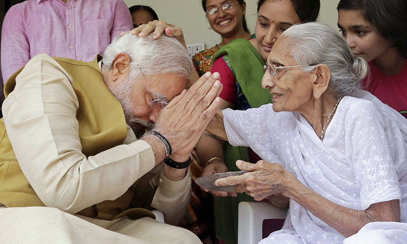 90-year-old Hiraben blesses her son and India's next prime minister Narendra Modi at her home in Gandhinagar, in the western Indian state of Gujarat, Friday, May 16, 2014. — Photo by AP