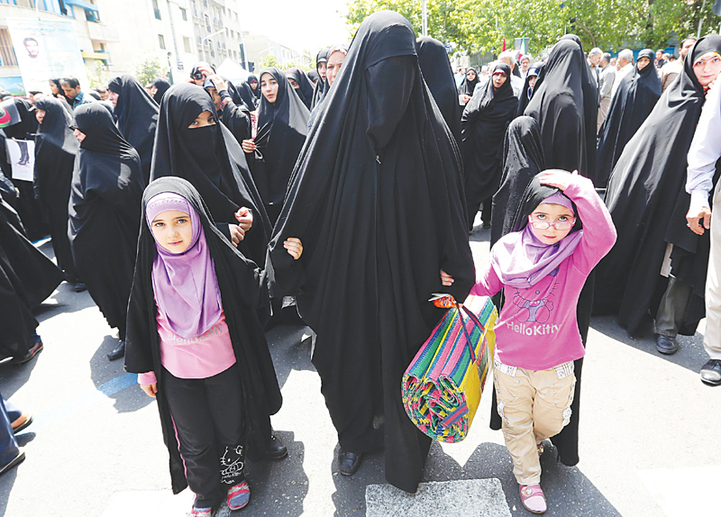 Tehran: Religious hardliners take part in a demonstration after Friday prayers  demanding that the government enforce obligatory rules that women appear fully veiled in public.—AFP