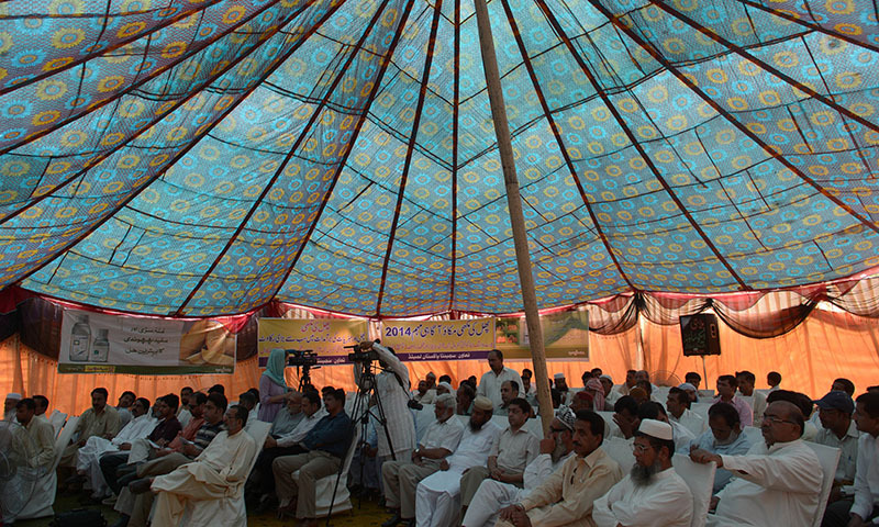 In this photograph taken on May 10, 2014,  Pakistani  landowner-farmers gather in a seminar at a fruit farm some 40 kilometres north-east of the central city of Multan. — Photo by AFP