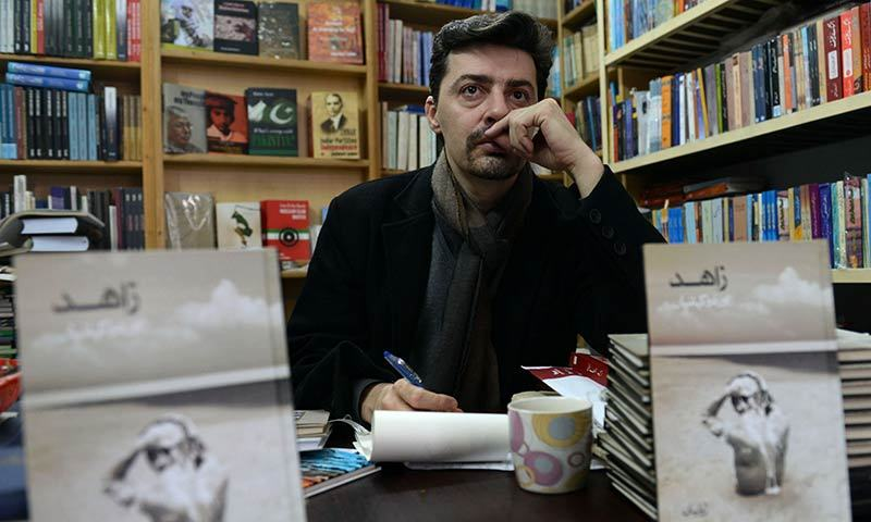 In this photograph taken on January 20, 2014 Frenchman Julien Columeau sits in a book store in Lahore. -AFP Photo