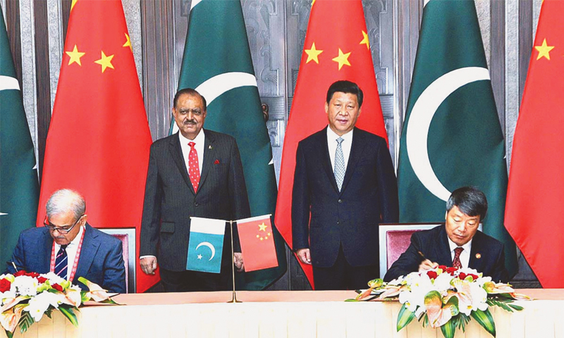 SHANGHAI: President Mamnoon Hussain and his Chinese counterpart Xi Jinping witnessing the signing of the framework agreement between China and Pakistan on Lahore Orange Line Metro Train Project on Thursday. Punjab Chief Minister Shahbaz Sharif signed the agreement from Pakistan side.—APP