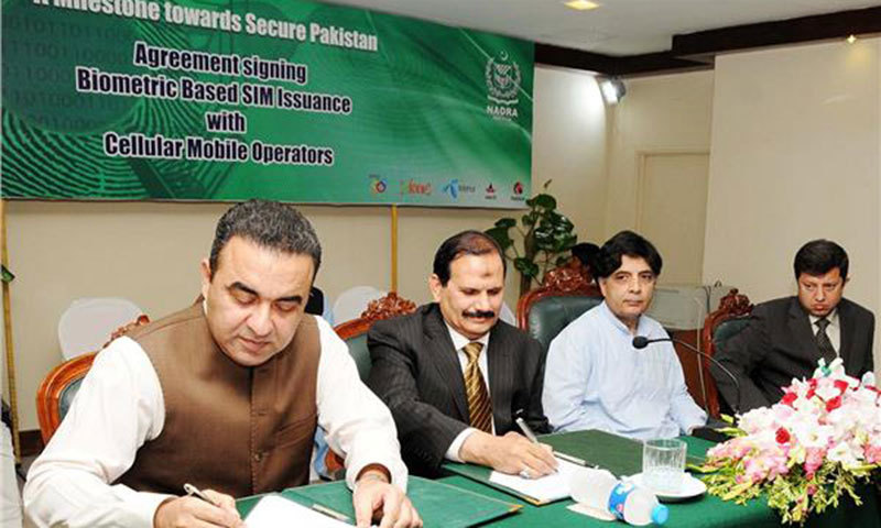 Interior Minister Chaudhry Nisar Ali Khan witnessing the signing ceremony of agreement between Nadra and telecom companies. — Photo by Online.