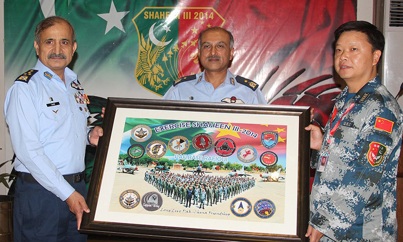 Air Chief Marshal Tahir Rafique Butt hands over a souvenir regarding Shaheen-III drills to Chinese delegation at an operational base in Pakistan on Saturday. – Photo provided by author