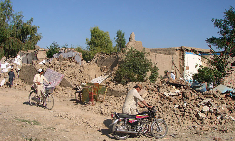 Pakistani tribesmen stand near their destroyed houses following Pakistan military airstrikes against suspected Taliban hideouts in Miramshah in North Waziristan on May 24, 2014. – AFP Photo