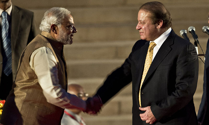Newly sworn-in Indian Prime Minister Narendra Modi shakes hands with Pakistani Prime Minister Nawaz Sharif after the swearing-in ceremony at the Presidential Palace in New Delhi on May 26, 2014. – AFP Photo