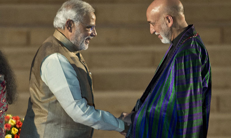 Newly sworn-in Indian Prime Minister Narendra Modi shakes hands with Afghan President Hamid Karzai after the swearing-in ceremony at the Presidential Palace in New Delhi on May 26, 2014. – AFP Photo