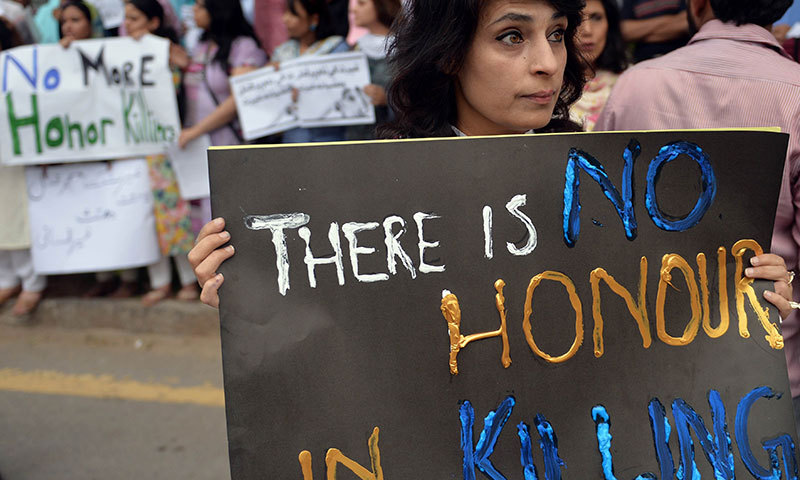 Pakistani human rights activists hold placards during a protest in Islamabad on May 29, 2014 against the killing of a pregnant woman Farzana Parveen. – AFP Photo