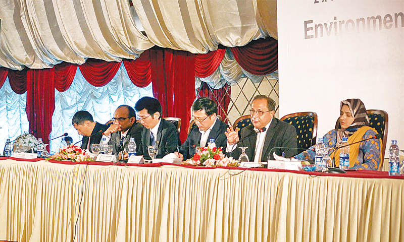Sepa DG Naeem Mughal speaks at a public hearing of the coal power plant's environmental impact assessment report at a hotel on Thursday.—White Star