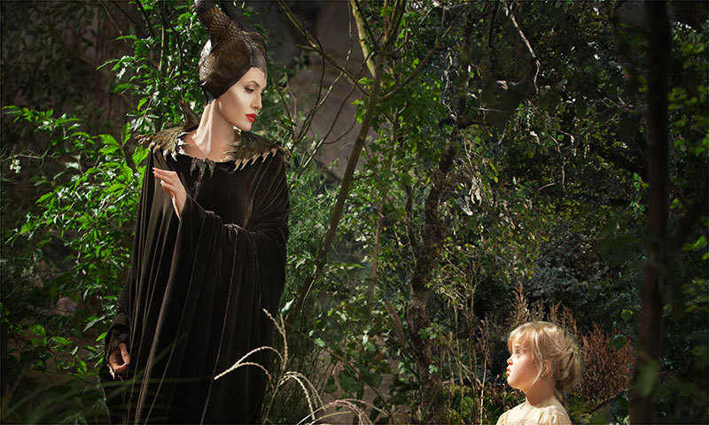 "This image released by Disney shows Angelina Jolie as Maleficent, left, in a scene with her daughter Vivienne Jolie-Pitt, portraying Young Aurora, in a scene from the film, ""Maleficent.""  – Photo by AP"