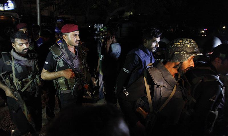 Pakistani commandos get ready to enter Karachi airport terminal following attacks by unknown gunmen on Sunday night. -AP Photo