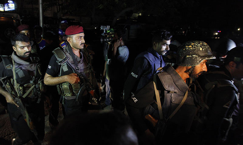 Pakistani commandos get ready to enter Karachi airport terminal following attacks by unknown gunmen on Sunday night. -AP Photo