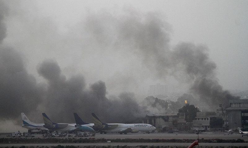 Smoke billows from Jinnah International Airport in Karachi, June 9, 2014. — Photo by Reuters