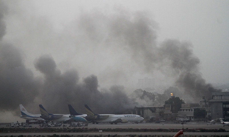 Smoke billows from Jinnah International Airport in Karachi, June 9, 2014. — Photo by Reuters