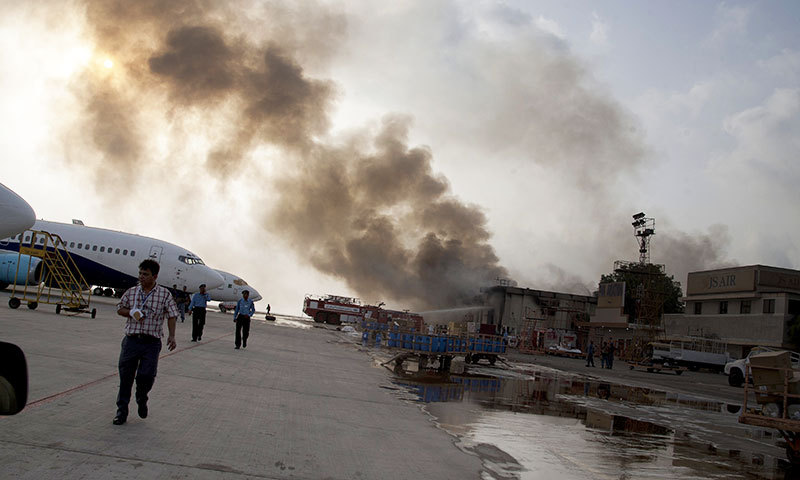 Smoke rises above Karachi airport terminal Monday, June 9, 2014 in Pakistan. — Photo by AP