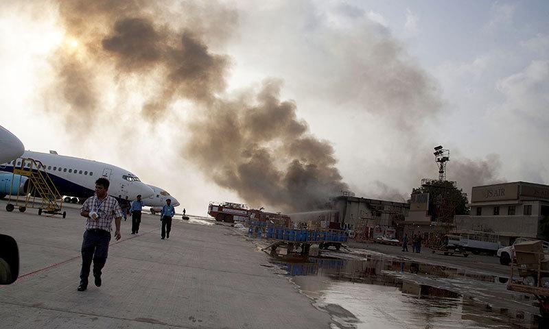 Smoke rises above Karachi airport terminal Monday, June 9, 2014 in Pakistan. — Photo by AP