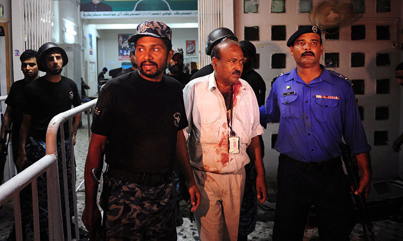 Airport employees leave the Jinnah International Airport after militants attack in Karachi on June 9, 2014. — Photo by AFP