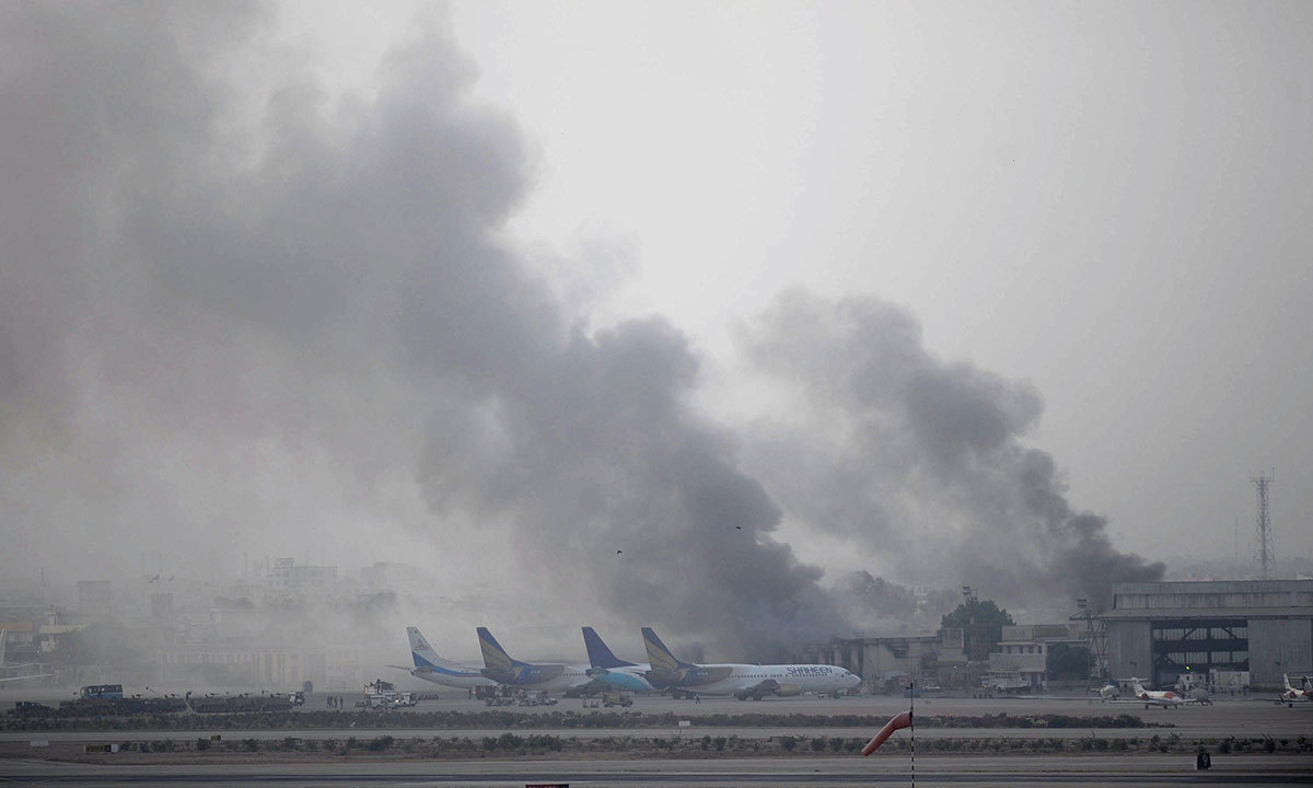 Smoke rises after militants launched an early morning assault at Jinnah International Airport in Karachi on June 9, 2014. Pakistan's security forces said on June 9 they have relaunched a military operation at Karachi airport as gunfire resumed several hours after they announced the end of a militant siege that left 24 dead.  Photo by AFP