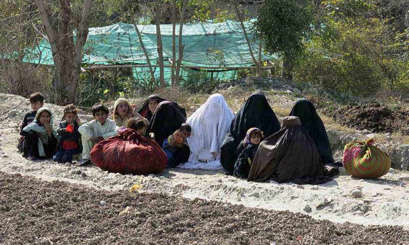 Women and children sit by a road, while fleeing from a military offensive against the Pakistani Taliban, on the outskirts of Bannu located in Khyber Pakhtunkhwa province January 28, 2014. Thousands of villagers have fled their homes in Pakistan's North Waziristan region, fearing a major military operation by armed forces after they said dozens of people had been killed in air strikes targeting Islamist militants earlier this month. -   Reuters