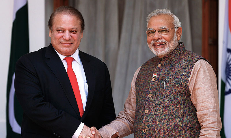 Indian Prime Minister Narendra Modi, right, poses for the media with his Pakistani counterpart Nawaz Sharif before the start of their meeting in New Delhi, India. -AP Photo