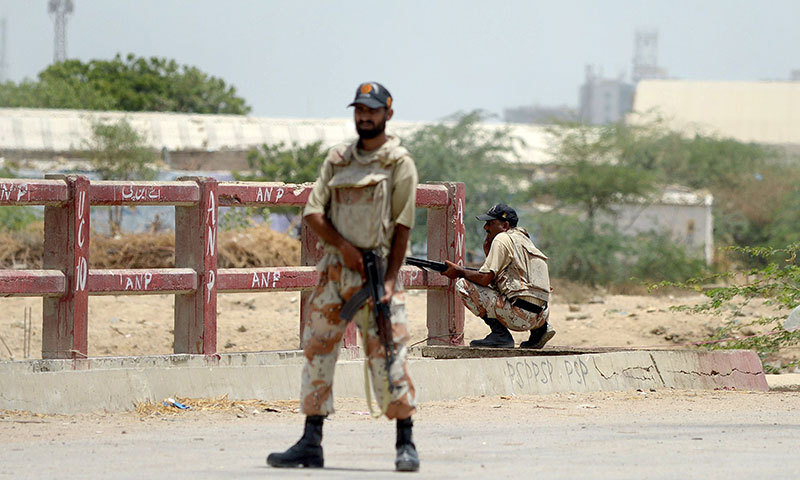Pakistan rangers take position after the firing incident near Karachi airport in Karachi on June 10, 2014. — Photo by AFP