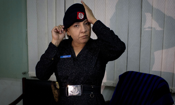 Police officer Syeda Ghazala, gets ready to leave for patrolling in Karachi. - Photo AP