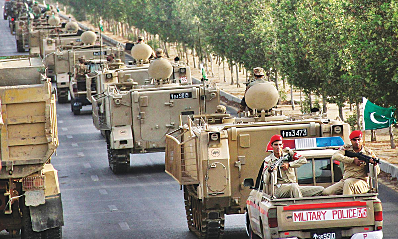 Army troops moving towards the city centre from the Malir Cantt on Monday in the wake of the army operation launched in North Waziristan.—Photo by Online