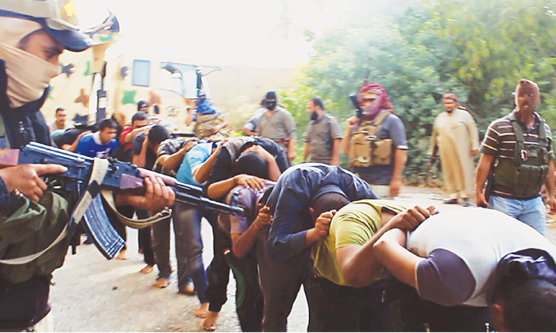 Image posted on a militant website appears to show members of the Islamic State of Iraq and Al Sham (ISIS) leading away captured Iraqi soldiers after taking over a base in Tikrit.—AP