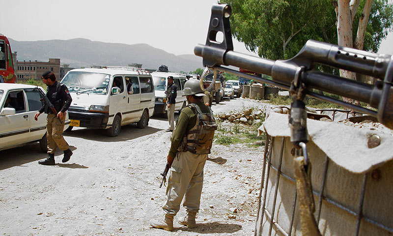 Pakistani security personnel keep watch at a checkpoint in Hangu, a town in the Khyber Pakhtunkhwa province, on June 17, 2014. – AFP Photo