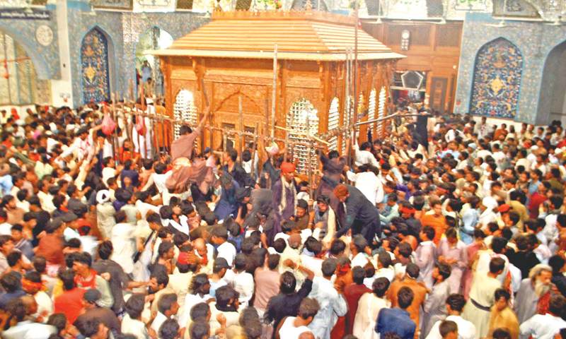 DEVOTEES surround the under-construction compound housing the grave of Hazrat Lal Shahbaz Qalandar during rituals on Tuesday, the first day of the three-day Urs.—Dawn