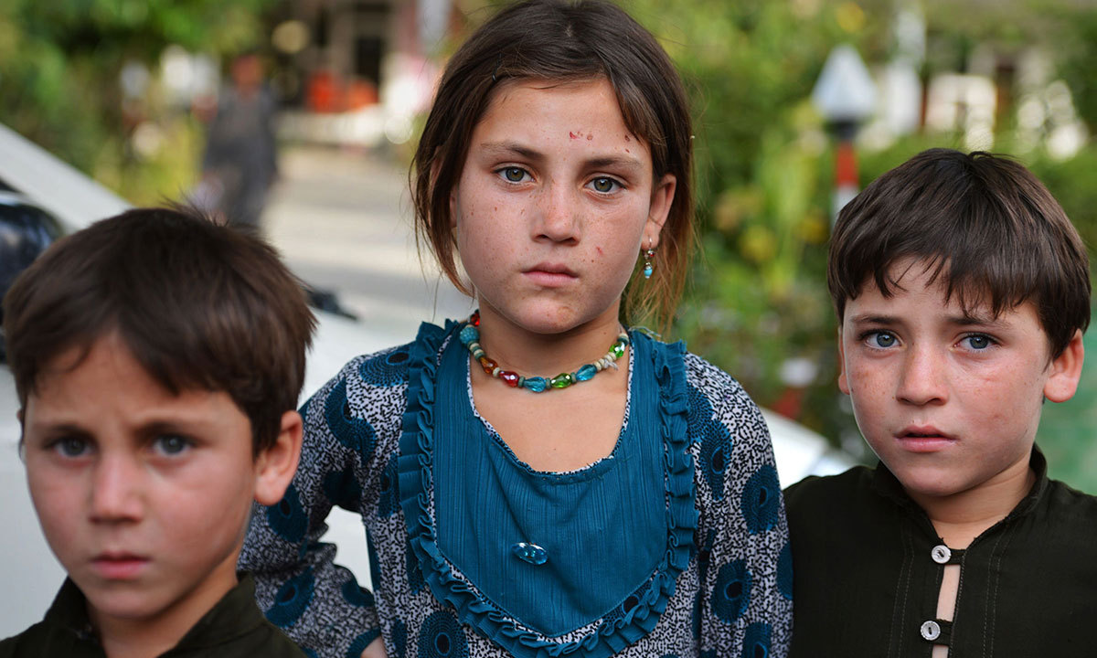 Children whose families fled the military operation in North Waziristan pose for a photograph in Bannu, June 16, 2014. — Photo by AFP