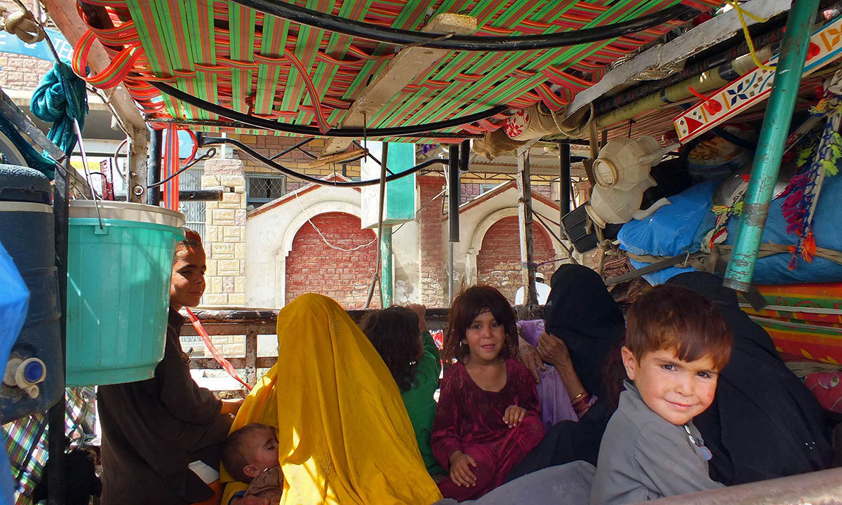 Civilians fleeing a military operation in North Waziristan arrive in Bannu on June 17, 2014. — Photo by AFP