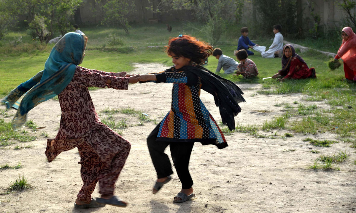 Internally displaced children from North Waziristan play as they shelter with their family at a school in Bannu on June 17, 2014. — Photo by AFP