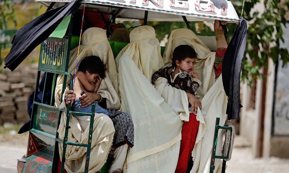 Families arrive in Bannu after fleeing their villages in North Waziristan, June 17, 2014. — Photo by AP