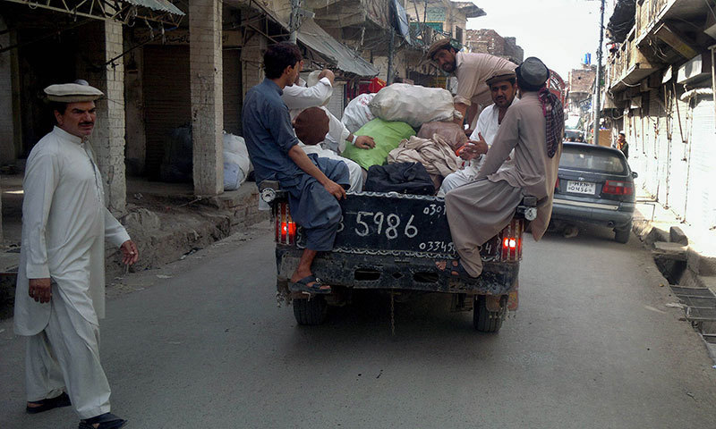 Shopkeepers flee from a military operation in North Waziristan tribal region, in Miramshah on June 18, 2014. — Photo by AFP