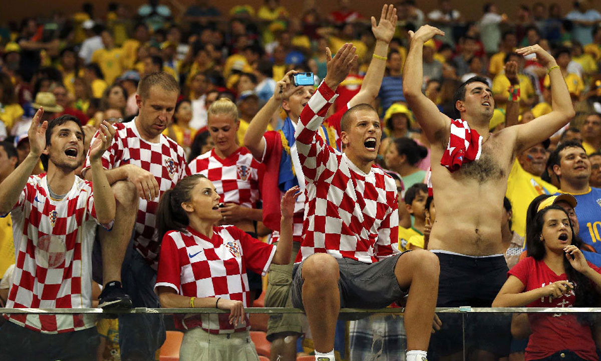 70e81fdf477 Croatia s fans celebrate during a Group A football match between Cameroon  and Croatia in the Amazonia