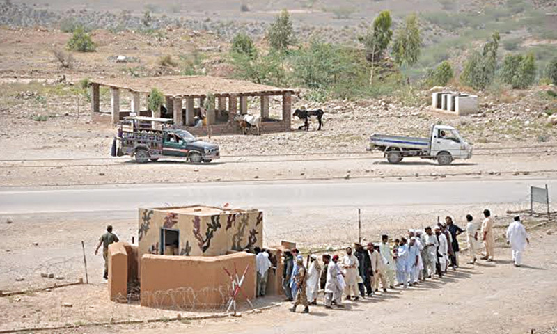 A handout picture shows displaced people being registered at a post in Saidgi.