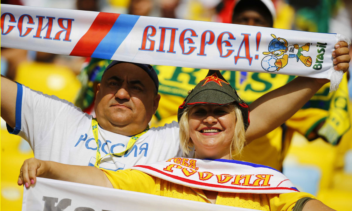 Fans of the Russia pose before the start of the 2014 World Cup Group H soccer against Belgium at the Maracana stadium in Rio de Janeiro June 22, 2014. — Photo by Reuters