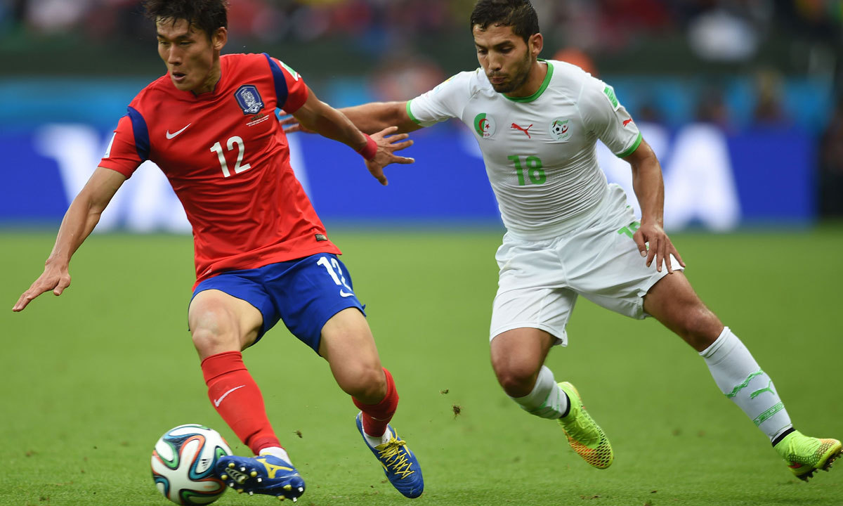 Algeria's forward Abdelmoumene Djabou (R) challenges South Korea's defender Lee Yong during the Group H football match between South Korea and Algeria at the Beira-Rio Stadium in Porto Alegre during the 2014 FIFA World Cup on June 22, 2014. — Photo by AFP