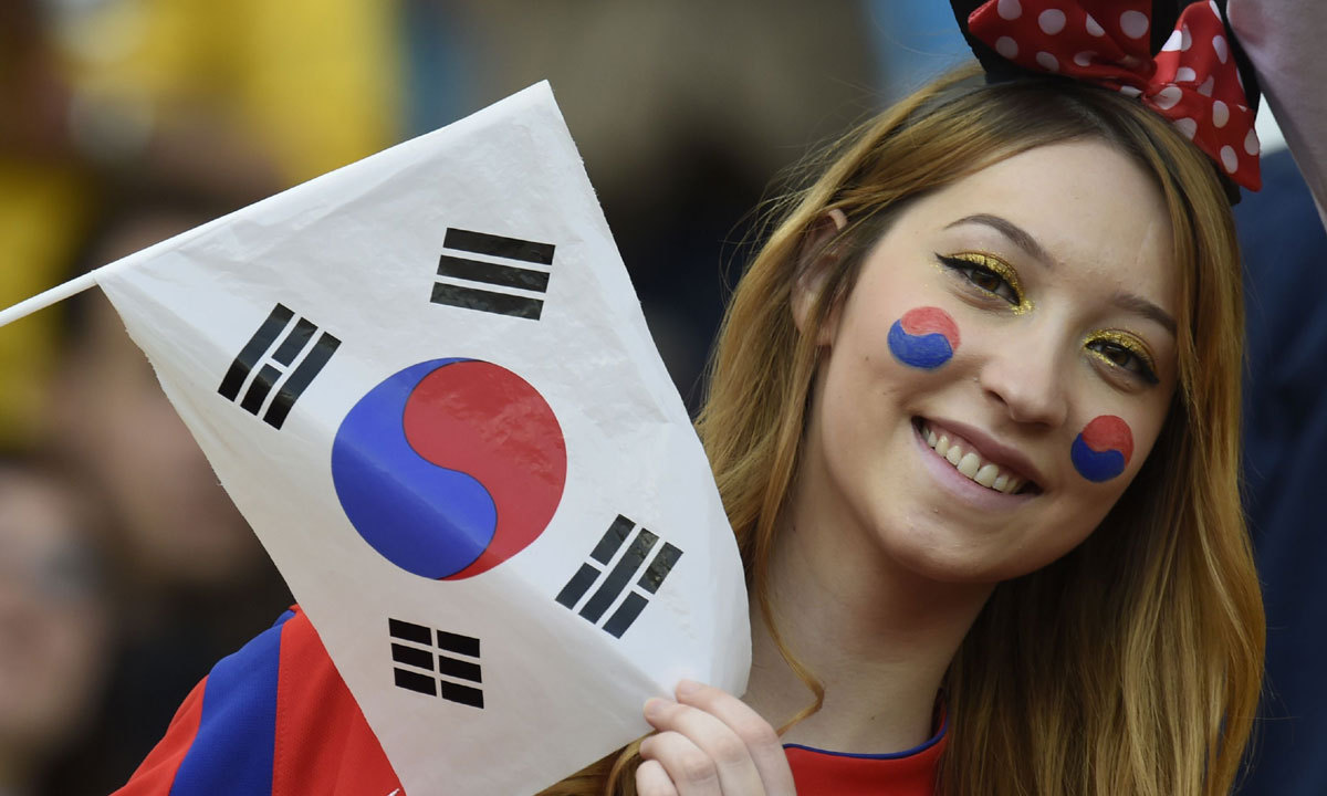 A South Korean fan cheers before a Group H football match between South Korea and Algeria at the Beira-Rio Stadium in Porto Alegre during the 2014 FIFA World Cup on June 22, 2014. — Photo by AFP