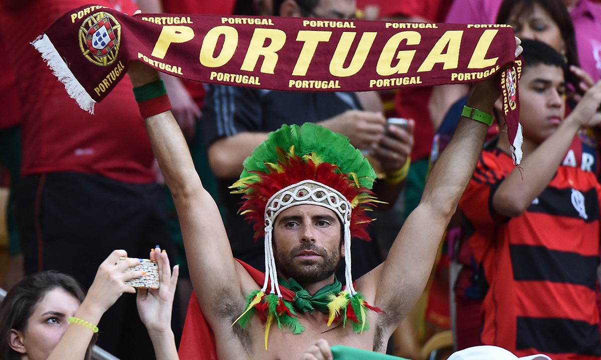 Portugal fans cheer before the start of a Group G match between USA and Portugal at the Amazonia Arena in Manaus during the 2014 FIFA World Cup on June 22, 2014. — Photo by AFP
