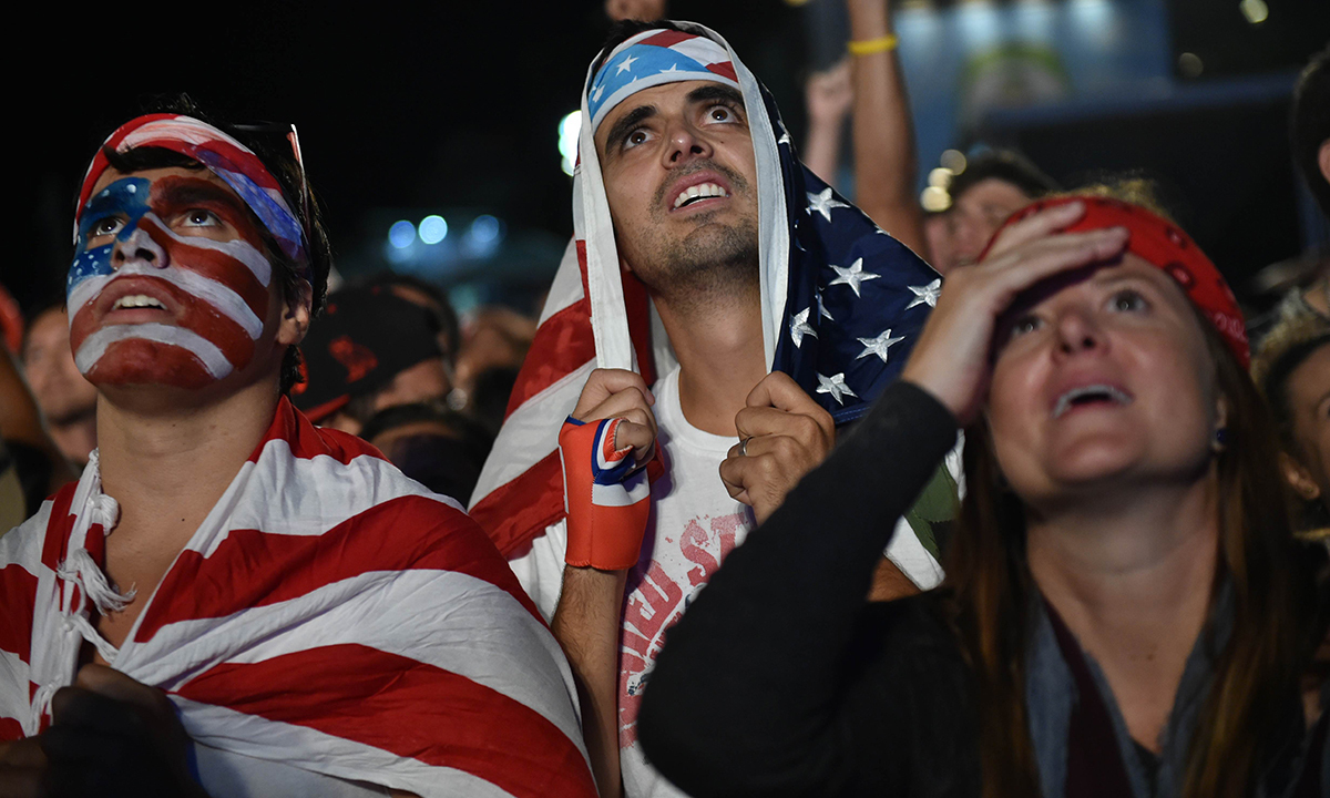 A US fan reacts while watching a 2014 World Cup Group G football match USA vs Portugal on a giant screen in Rio de Janeiro, on June 22, 2014. — Photo by  AFP