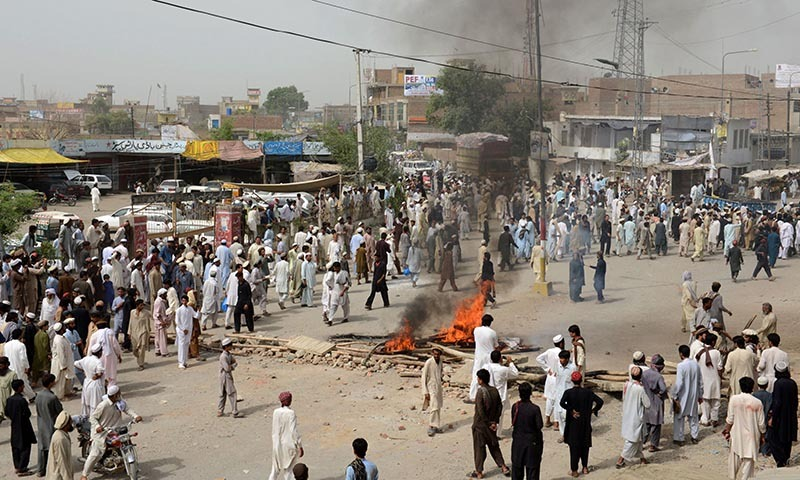 Internally displaced persons protest outside a World Food Programme (WFP) food distribution point in Bannu on June 24, 2014. — Photo by AFP