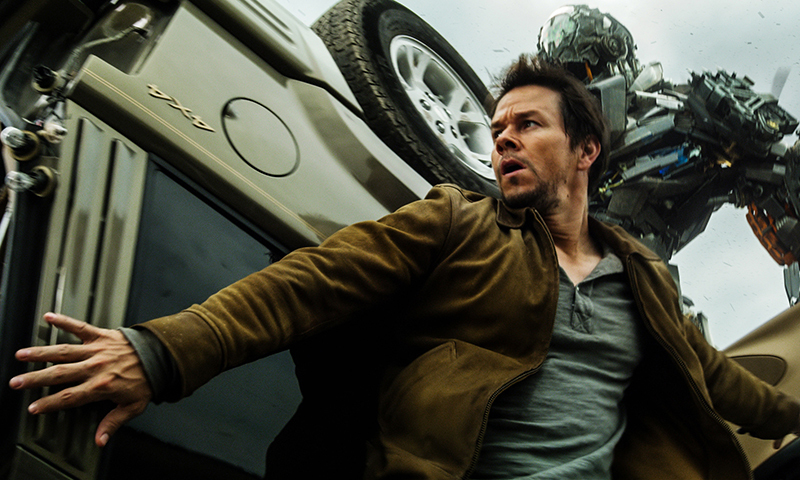 Mark Wahlberg, front, as Cade Yeager, and Lockdown, rear, in a scene from the the film, Transformers: Age of Extinction. — Photo by AP