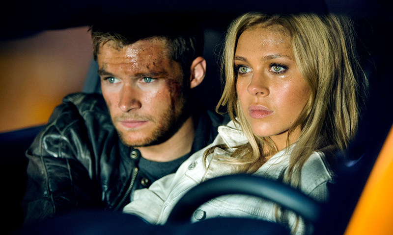 Nicola Peltz, right, as Tessa Yeager, and Jack Reynor as Shane Dyson, in the film, Transformers: Age of Extinction. — Photo by AP